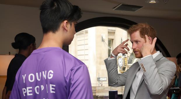 The Duke of Sussex talks to Mahir Rahman during the Diana Award National Youth Mentoring Summit (PA)
