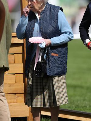 The Queen holding a rosette after her horse finished 5th (Steve Parsons/PA)
