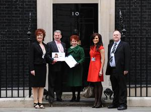 Michael Brown (second left) and (L to R) Mr Brown's partner Elizabeth Betts, Labour MP Hazel Blears, Michelle Livesey of radio station Key 103, and Clare Wood's brother Adam Brown-Wilkinson handing in a petition at 10 Downing Street (Dominic Lipinski/PA)