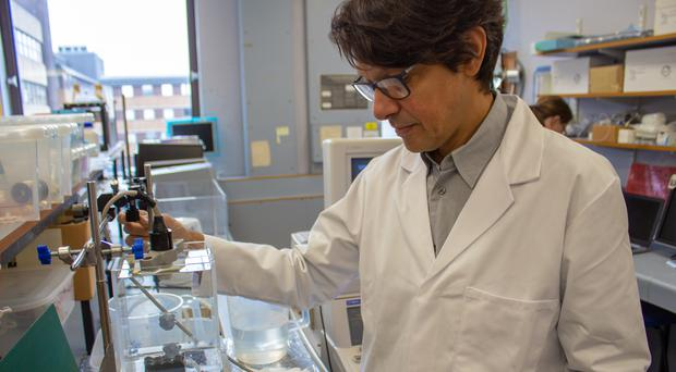 Dr Vassilis Sboros, who led the research, testing out the new technology in the lab (PA)