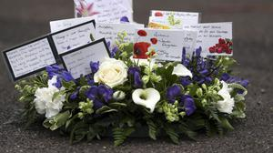 Floral tribute which was laid during a memorial service for Pc Andrew Harper at Newbury Police Station to mark the first anniversary of his death (Steve Parsons/PA)