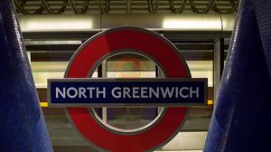 North Greenwich Tube station in south east London, where a suspicious device was discovered on Thursday. A 19-year-old man was seized in the street in Holloway Road, north London, on Friday in an armed anti-terror operation linked to the discovery