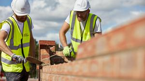 UK GDP declined in February on the back of a slump in the construction sector (Taylor Wimpey/PA)