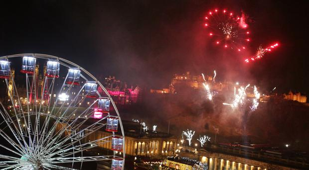Edinburgh during the Hogmanay New Year celebrations (David Cheskin/PA)