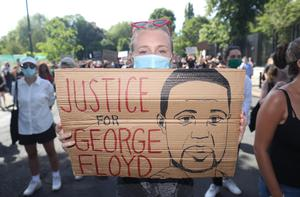 People at a Black Lives Matter protest rally outside the US Embassy in Dublin following the death of George Floyd in Minneapolis, US (Niall Carson/PA)