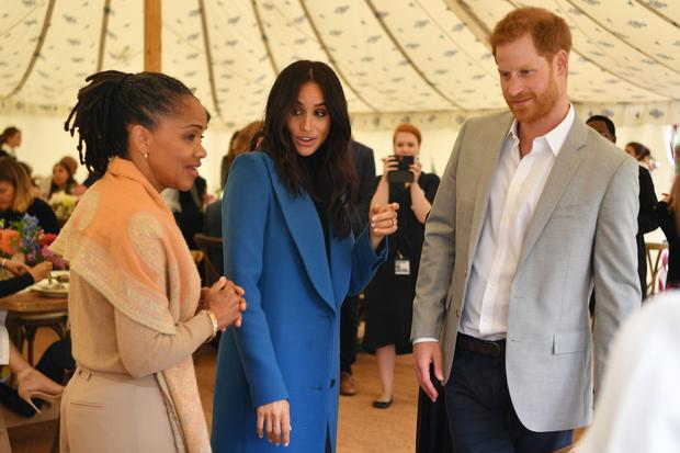 Meghan and Harry with the duchess' mother Doria Ragland who has been a presence in Archie's life (Ben Stansall/PA)