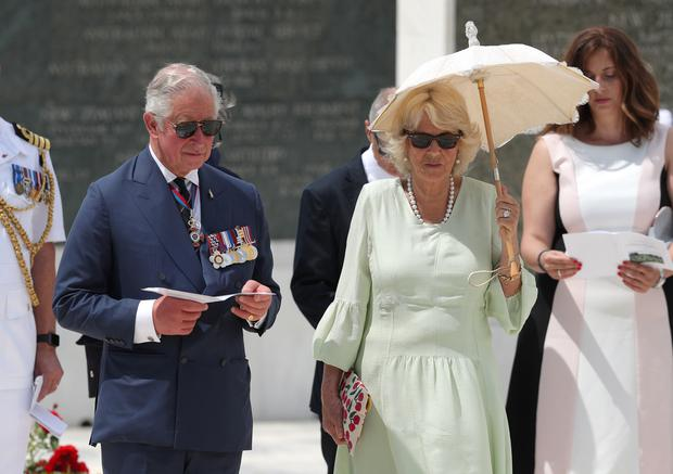 The Prince of Wales and the Duchess of Cornwall during a previous visit to the Commonwealth War Graves in Athens (Andrew Matthews/PA)