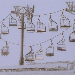 The chairlift at the Lecht ski centre in Aberdeenshire with one side of the lift hanging down