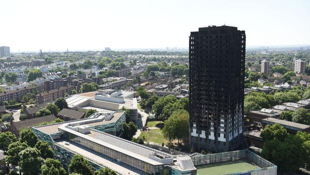 Families met Theresa May and she was presented with art depicting Grenfell Tower. (David Mirzoeff/PA)