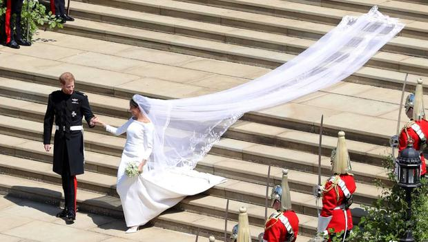 Meghan's veil train covers the steps (Andy Matthews/PA)