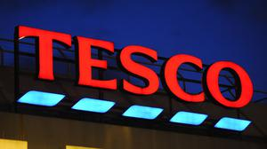 General view of a Tesco sign in Brixton, London, as the supermarket giant announces job cuts for bakery staff (Charlotte ball/PA)