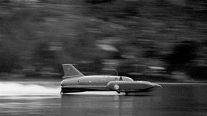 Donald Campbell pilots Bluebird before the disaster on Coniston Water in 1967 (PA)
