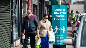 People wearing PPE in the Spinney Hills area of Leicester (Jacob King/PA)