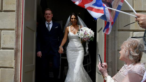 The happy couple outside Windsor Guildhall following their wedding (Ben Birchall/PA)