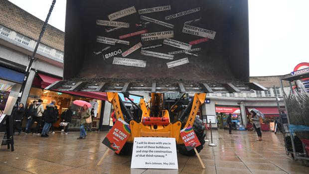 Protestors from Greenpeace with a bulldozer outside Uxbridge Tube station in Boris Johnson's constituency (Kirsty O'Connor/PA)