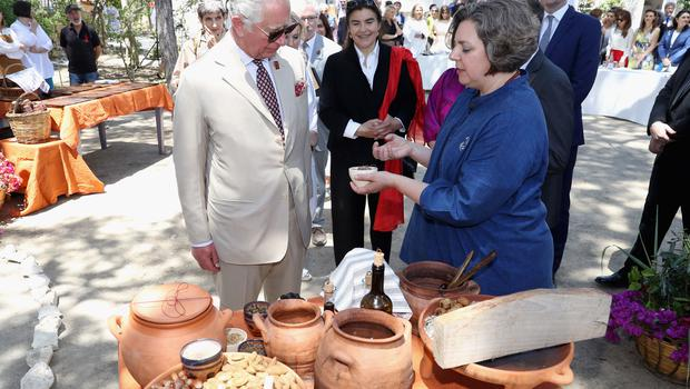 Charles, in his role as Patron of the British School at Athens, meets people taking part in a Cooking Like Minoans event at the Knossos Archaeological Site on the island of Crete (Chris Jackson/PA)