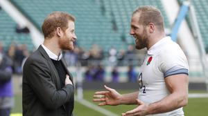 Prince Harry talks to England player James Haskell during training at Twickenham (Heathcliff O'Malley/The Daily Telegraph/PA)