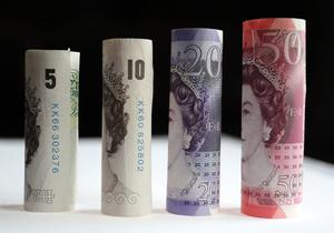 Lacklustre wage growth and higher inflation has caused households to cut back on spending (Chris Radburn/PA)