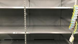 Empty shelves where toilet roll is usually stocked (Aaron Chown/PA)