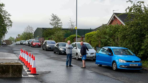People queue in their cars outside a household waste recycling plant in Manchester (Peter Byrne/PA)