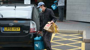 Domino's is angry at the CMA waiving through provisionally the deal to allow Amazon to buy a stake in Deliveroo (Nick Ansell/PA)