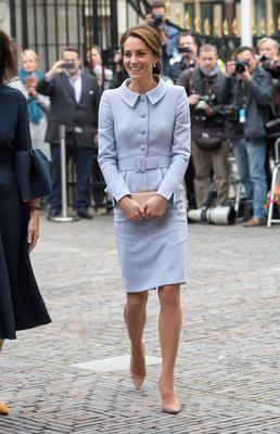Catherine looks radiant in a simple pale lavender suit