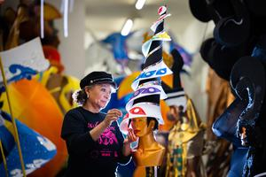 Clary Salandy adjusts a costume for the first virtual Notting Hill Carnival at her shop in Harlesden, north London (Aaron Chown/PA)