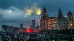 Fireworks go off outside the Liver Building in Liverpool (Peter Byrne/PA)