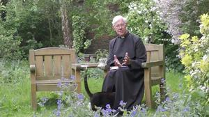 The Dean of Canterbury recording a sermon, which was interrupted by the cathedral cat (PA)