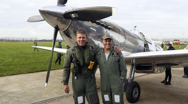 Pilots Matt Jones, left, and Steve Brooks after successfully circumnavigating the globe in a newly restored Spitfire (Steve Parsons/PA)