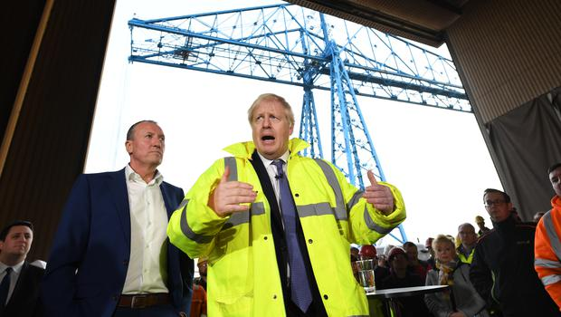 Boris Johnson, visiting Wilton Engineering Services in Middlesbrough, has hinted at a rise in National Insurance thresholds (Stefan Rousseau/PA)
