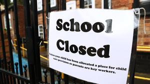 File photo dated 30/03/20 of a sign on the gates of a closed school. (Tim Goode/PA)
