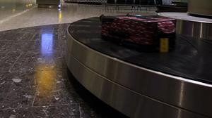 Baggage handling jobs are said to be at risk (Steve Parsons/PA)