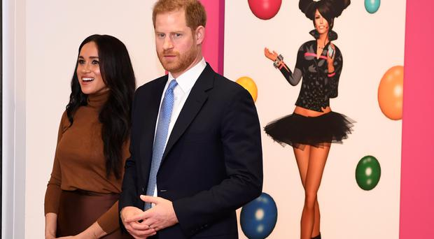 The Duke and Duchess of Sussex are to step back from royal duties (PA)