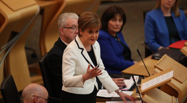 Nicola Sturgeon issues a statement on Brexit and independence to Holyrood (Jane Barlow/PA)