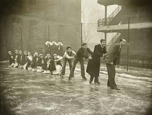 Photos show off-duty fun, such as this one of nurses and students ice-skating on a tennis court at the London Fever Hospital (Historic England Archive/PA)