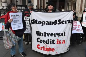 Campaigners make their views about universal credit known (Stefan Rousseau/PA)