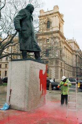 A Westminster council worker cleans the statue of Sir Winston Churchill, which had been defaced with red paint in 2007 (Joel Ryan/PA)