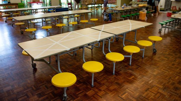 Tables marked showing where children can sit during dinner time at Kempsey Primary School in Worcester (Jacob King/PA)
