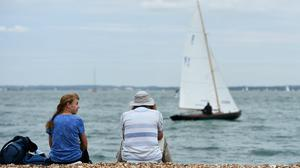 Spectators watch the boat racing in Cowes, Isle of Wight, which is expected to have a particularly resilient tourism and hotel sector (Andrew Matthews/PA)
