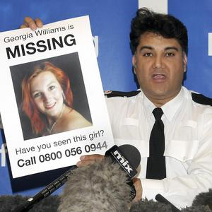 Police Superintendent Nav Malik from West Mercia Police holds up a poster of missing teenager Georgia Williams, 17, of Wellington in Shropshire