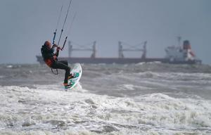 Kite surfers off Tynemouth beach in north-east England (Owen Humphreys/PA)