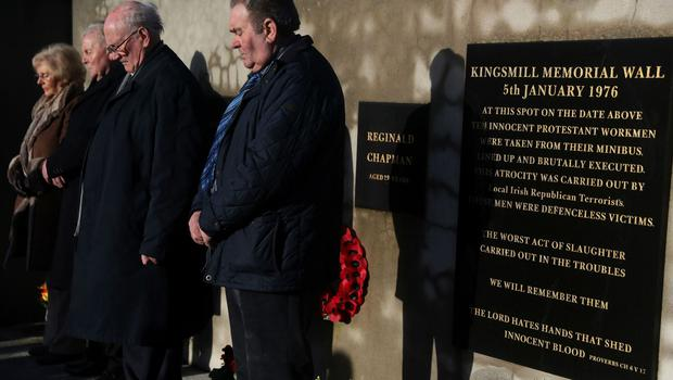 People attend a roadside service marking the 42nd anniversary of the Kingsmill massacre (Brian Lawless/PA)
