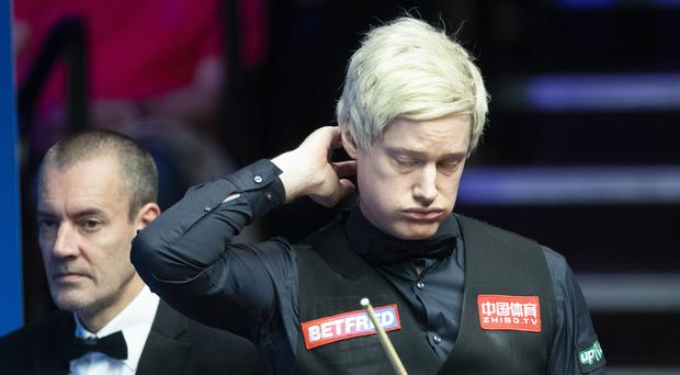 Neil Robertson in action against Shaun Murphy during day six of the 2019 Betfred World Championship at The Crucible, Sheffield.
