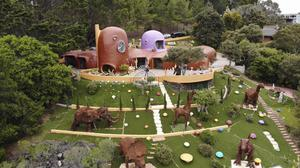 An aerial view of the Flintstones House in Hillsborough, California (Terry Chea/AP)