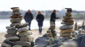 Pebble sculptures in Whitley Bay beach on the North East coast (Owen Humphreys/PA)