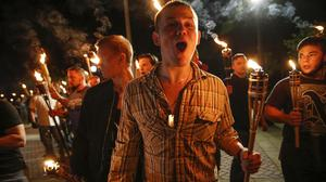 Alt-right protesters used torches as they marched(Mykal McEldowney/AP)