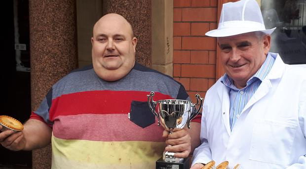 World Pie Eating champion Ian Gerrard, left, with pie master Tony Callaghan (Tony Callaghan/PA)