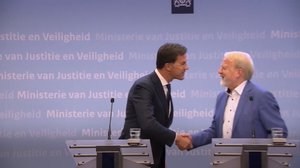 Dutch Prime Minister Mark Rutte shakes hands before realising his mistake (PA, RTL Netherlands, AP)