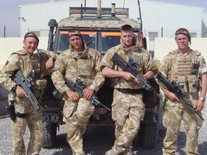 Darren Hardy, 2nd from right, during his time in the armed forces (Handout/PA)